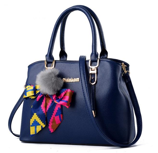 [ Pre-Order ] - กระเป๋าแฟชั่น ถือ/สะพาย สีน้ำเงินเข้ม ทรงตั้งได้ แต่งโบว์ป้อมเก๋ๆ ดีไซน์สวยเรียบหรู ดูดี งานหนังคุณภาพ ช่องใส่ของเยอะ สำเนา