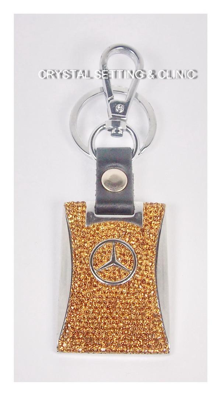 พวงกุญแจรถยนต์ยี่ห้อ BENZ สีทอง ( BENZ Keyring in gold color )