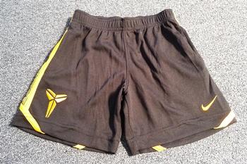 ฺBP-006 (4Y,7Y) กางเกงกีฬา Nike สีดำ ติดแถบเหลือง ปักแบรนด์ Nike สีเหลือง